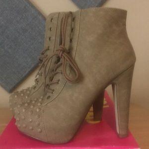 Spike toe high heeled lace up booties